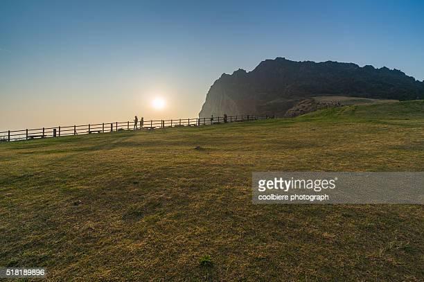 seongsan ilchulbong peak - jeju stock photos and pictures