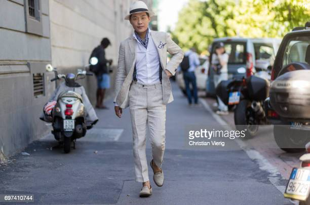 Seongsu Kim wearing beige suit suspenders hat is seen outside MSGM during Milan Men's Fashion Week Spring/Summer 2018 on June 18 2017 in Milan Italy