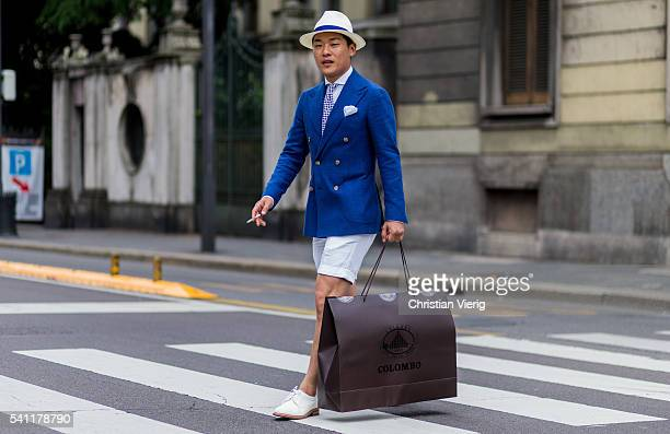 Seongsu Kim with a shopping bag outside Neil Barrett during the Milan Men's Fashion Week Spring/Summer 2017 on June 18 2016 in Milan Italy