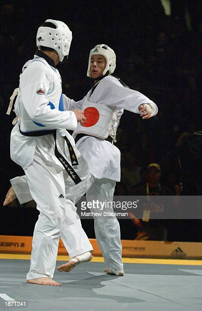 Seon-taek Oh of Korea fights Steve Lopez in Taekwondo during the Titan Games on February 15, 2003 at the Event Center at San Jose State University in...