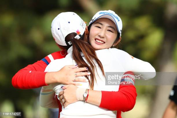 Seonwoo Bae of South Korea is congratulated by Bo-Mee Lee of South Korea after winning the tournament on the 18th green during the final round of the...