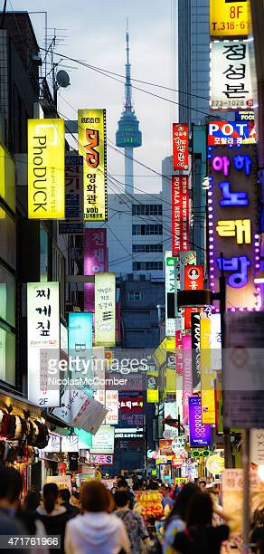 Seoul commercial shopping back street at dusk vertical panorama