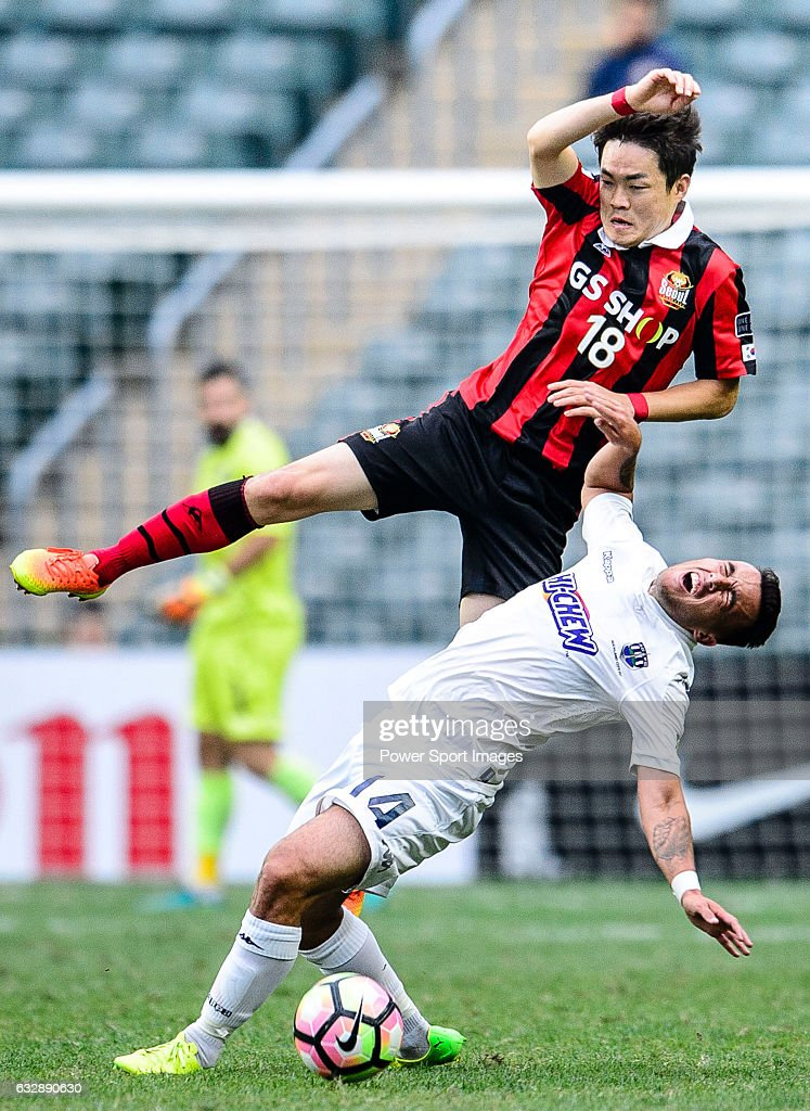 FC Seoul Defender Shin Kwang Hoon (r) collides with Auckland City Midfielder Clayton Lewis (l) during the 2017 Lunar New Year Cup match between Auckland City FC (NZL) and FC Seoul ((KOR) on January 28, 2017 in Hong Kong, Hong Kong.