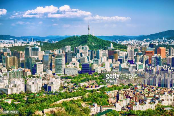 seoul downtown cityscape with fortress and namsan seoul tower on sunset seoul, south korea. - seoul stock pictures, royalty-free photos & images