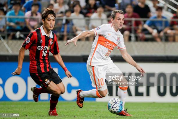 Seoul forward Park Chuyoung fights for the ball with Shandong Luneng FC midfielder Walter Montillo during the AFC Champions League 2016 Quarter Final...