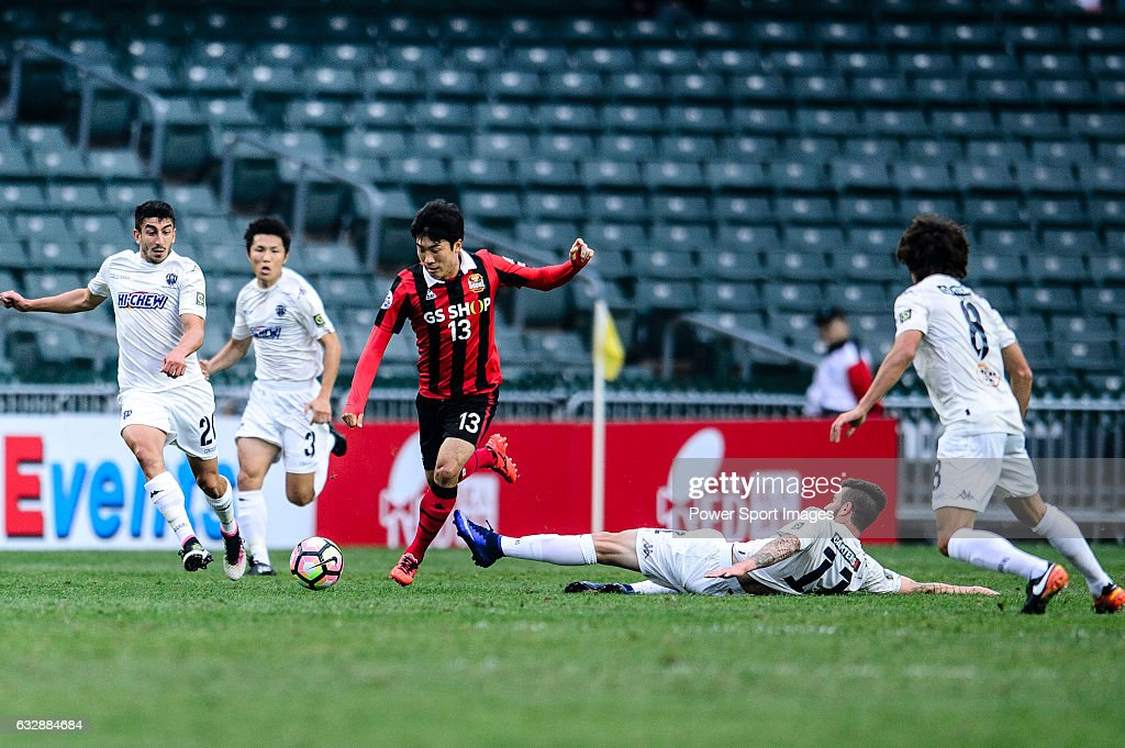 FC Seoul Midfielder Go Yo Han (c) trips up with Auckland City Midfielder Fabrizio Tavano (r) during the 2017 Lunar New Year Cup match between Auckland City FC (NZL) and FC Seoul ((KOR) on January 28, 2017 in Hong Kong, Hong Kong.