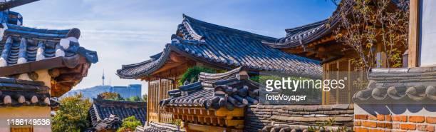 seoul namsan tower overlooking bukchon hanok village panorama korea - korean culture stock pictures, royalty-free photos & images