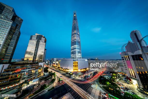 seoul songpagu cityscape skyscraper lotte world tower at night - seoul stock pictures, royalty-free photos & images
