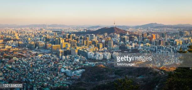 seoul sunset panorama over crowded skyscraper cityscape south korea - seoul stock pictures, royalty-free photos & images
