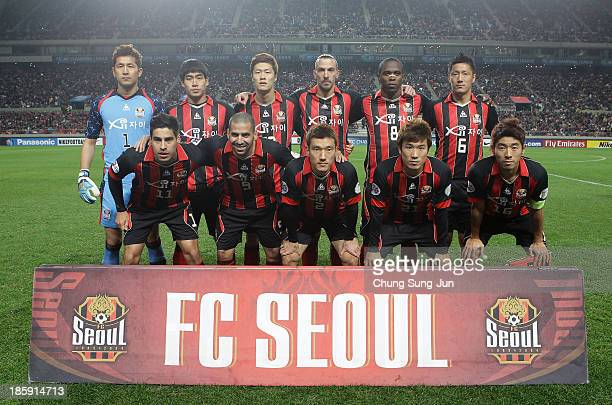 Seoul team players pose during the AFC Champions League Final 1st leg match between FC Seoul and Guangzhou Evergrande at Seoul World Cup Stadium on...