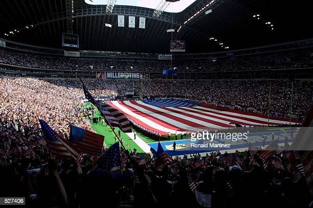 Huge American flag stretches across the field before a game between the San Diego Chargers and Dallas Cowboys at Texas Stadium in Irving, Texas....