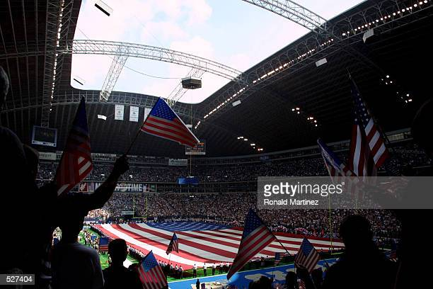 American flags wave across the field before a game between the San Diego Chargers and Dallas Cowboys at Texas Stadium in Irving Texas Chargers defeat...