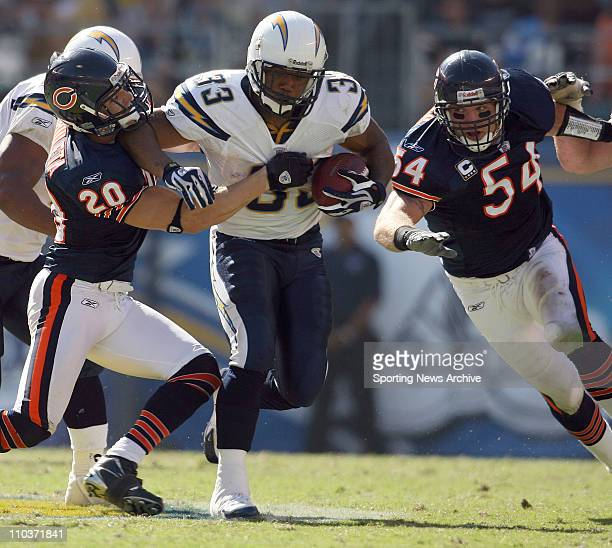 Sep 09 2007 San Diego CA USA Chicago Bears ADAM ARCHULETA and BRIAN URLACHER against San Diego Chargers MICHAEL TURNER at Qualcomm Stadium in San...