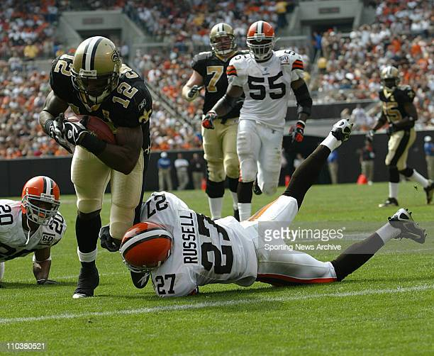 Sep 10 2006 Cleveland OH USA NFL FOOTBALL New Orleans Saints MARQUES COLSTON is tackled by Cleveland Browns BRIAN RUSSELL in Cleveland Ohio on Sept...