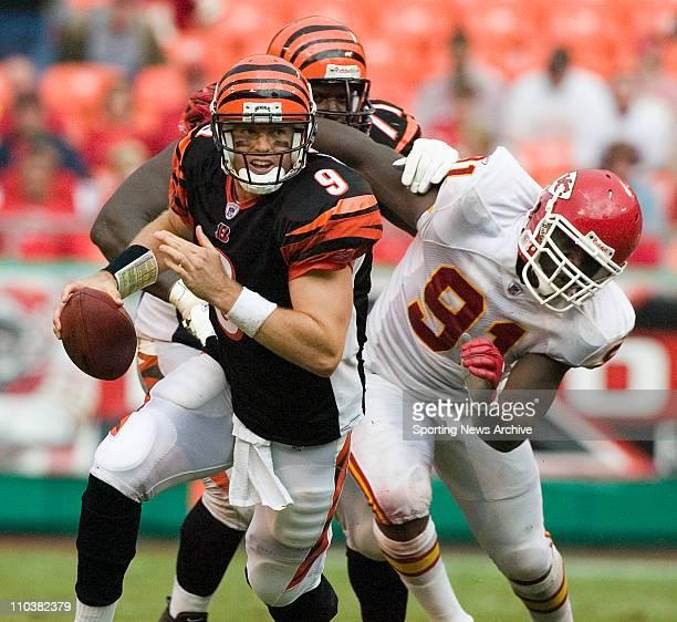 Sep 10, 2006; Kansas City, MO, USA; NFL FOOTBALL: Cincinnati Bengals CARSON PALMER scrambles from Kansas City Chiefs TAMBA HALI in Kansas City, MO....