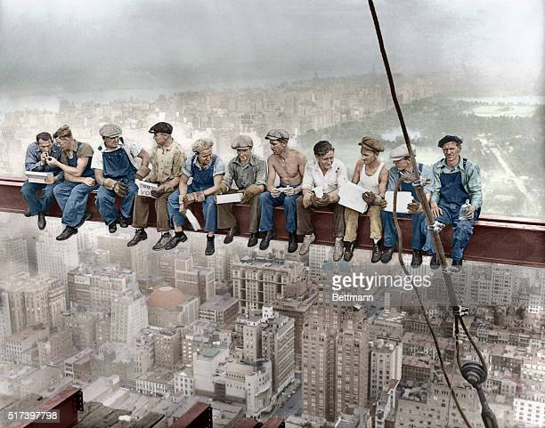 29 Sep 1932 Manhattan New York City New York State USA Construction workers eat their lunches atop a steel beam 800 feet above ground at the building...