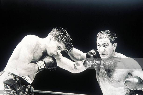 Rocky Marciano lands a right hand on his way to beating Roland La Starza in the Heavyweight Title fight at the Polo Grounds in New York, USA....