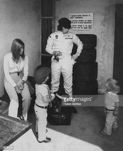 Italian Formula 1 Grand Prix, Monza. Reigning World Champion driver Jackie Stewart in the pits with his wife Helen and two sons Paul, left with...