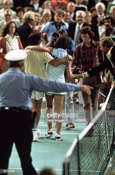 Bobby Riggs of the USA comes off court defeated by Billie JeanKing of the USA after a Battle of the Sexes Challenge Match held at the Astrodome in...