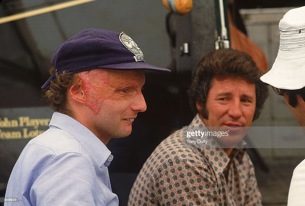Ferrari driver Niki Lauda sits with Mario Andretti at the Formula One Italian Grand Prix at Monza in Italy. It is Lauda's first race back since his accident at the Nurburgring track, Lauda finished 4th.