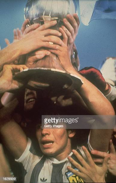 Portrait of Diego Maradona of Argentina holding the trophy aloft after the World Youth Cup against the USSR at the National Stadium in Tokyo...