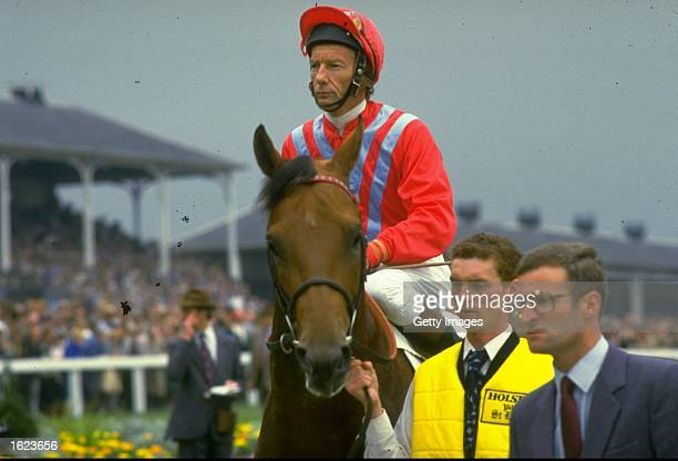 Lester Piggott of Great Britain on Commanche Run before the St. Leger at Doncaster racecourse in Doncaster, England. Piggot won the race and broke...