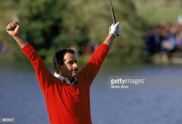 Sam Torrance of the European Team celebrates after holing the putt on 18 to secure victory in the Ryder Cup at the Belfry in Sutton Coldfield,...