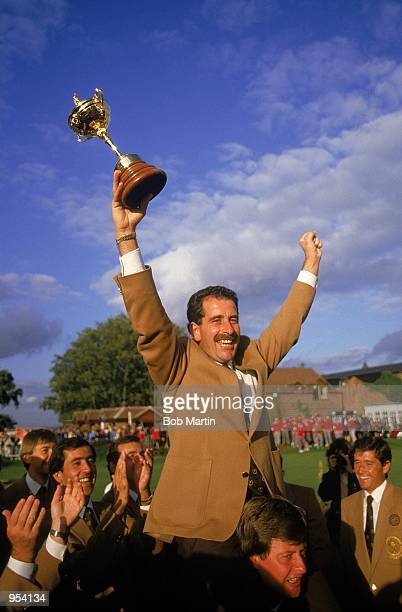 Sam Torrance of the European team celebrates with the trophy after victory over the USA in the Ryder Cup at the Belfry in Sutton Coldfield in England...