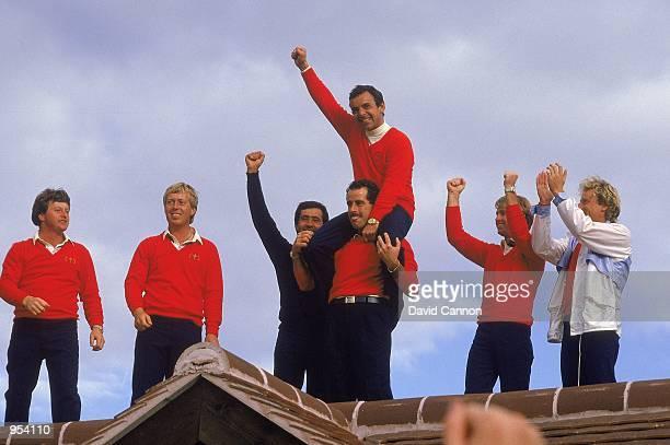 The European team Ian Woosnam, Howard Clark, Seve Ballesteros, captain Tony Jacklin, Sam Torrance, Paul Way and Bernhard Langer salute the crowd...