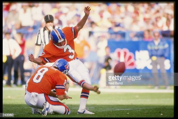 Kicker Rich Karlis of the Denver Broncos kicks the ball during a game against the New England Patriots at Mile High Stadium in Denver Colorado The...