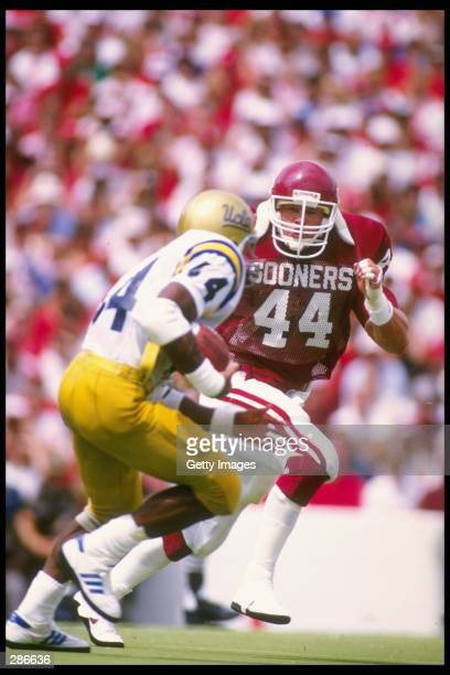 Linebacker Brian Bosworth of the University of Oklahoma pursues a UCLA running back during the Sooners 383 win over UCLA at Memorial Stadium in...