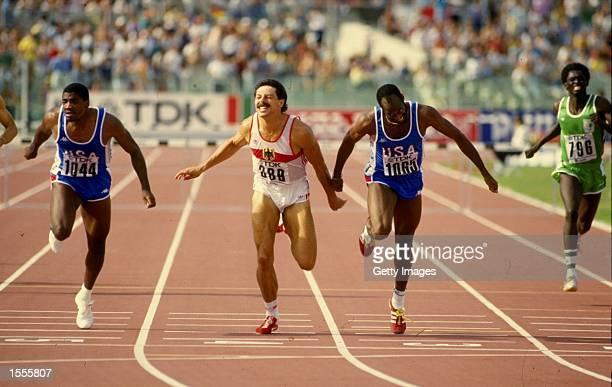 Danny Harris of the USA Harald Schmid of West Germany and Ed Moses also of the USA in action during the Mens 400 metres Hurdles event of the World...