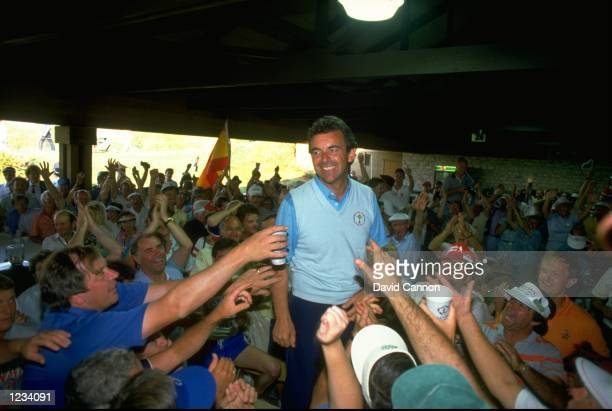 European Ryder Cup captain Tony Jacklin is mobbed by fans after victory over the USA in the Ryder Cup at Muirfield Village, Ohio, USA. \ Mandatory...