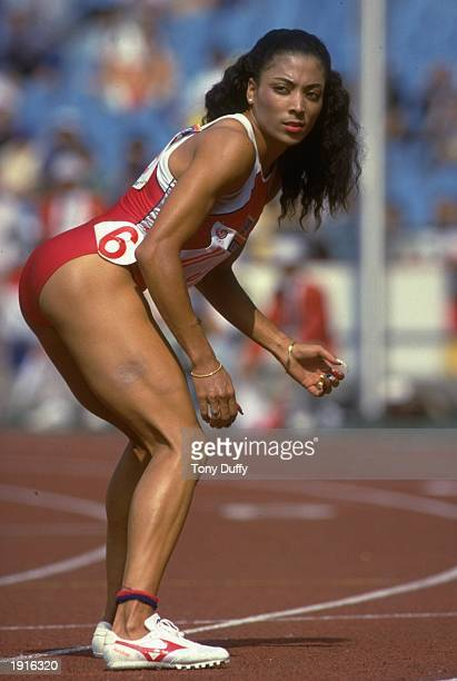 Florence GriffithJoyner of the USA waits for the baton during the 4x100 Metres Relay event at the 1988 Olympic Games in Seoul South Korea The USA...