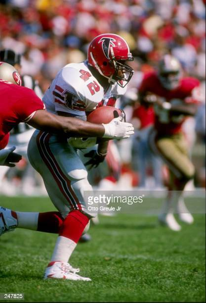 Fullback Gerald Riggs of the Atlanta Falcons runs with the ball during a game against the San Francisco 49ers at Candlestick Park in San Francisco,...