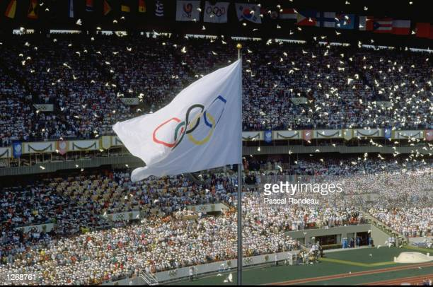 General view of the Olympic Flag in the Olympic Stadium as the doves are released during the Opening Ceremony of the 1988 Olympic Games in Seoul,...