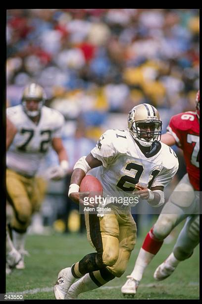 Halfback Dalton Hilliard of the New Orleans Saints runs with the ball during a game against the Atlanta Falcons at Fulton County Stadium in Atlanta...