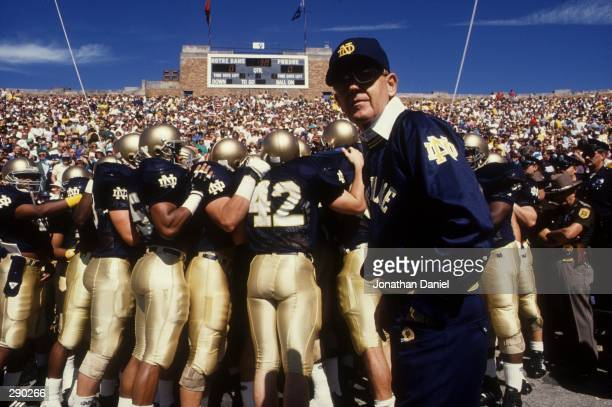 Head coach Lou Holtz of the University of Notre Dame leads his team onto the field prior to the Fighting Irish 52-7 win over Purdue at Notre Dame...