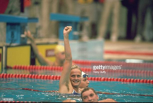 Kristin Otto of East Germany punches the air after winning the 100 Metres Freestyle event at the 1988 Olympic Games in Seoul South Korea Mandatory...