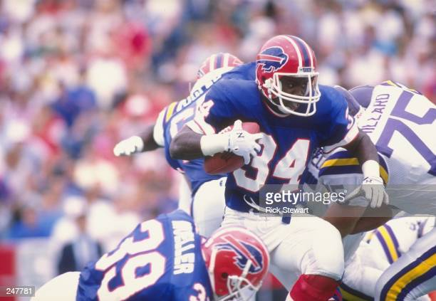 Running back Thurman Thomas of the Buffalo Bills runs with the ball during a game against the Minnesota Vikings at Rich Stadium in Orchard Park New...