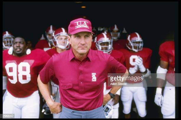 Coach Bill Curry of the Alabama Crimson Tide walks onto the field with his players before a game against the Kentucky Wildcats at Legion Field in...
