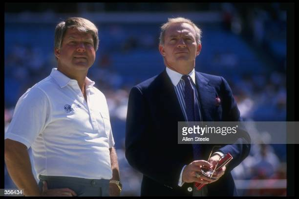 Dallas Cowboys head coach Jimmy Johnson and owner Jerry Jones look on during a game against the Atlanta Falcons at Fulton County Stadium in Atlanta...