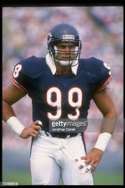 Defensive lineman Dan Hampton of the Chicago Bears looks on during a game against the Cincinnati Bengals at Riverfront Stadium in Cincinnati Ohio The...
