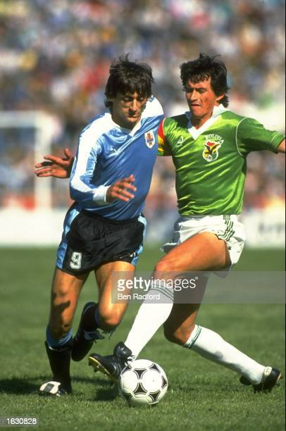 Enzo Francescoli of Uruguay is tackled during the World Cup qualifying match against Bolivia in Uruguay Uruguay won the match 20 Mandatory Credit Ben...