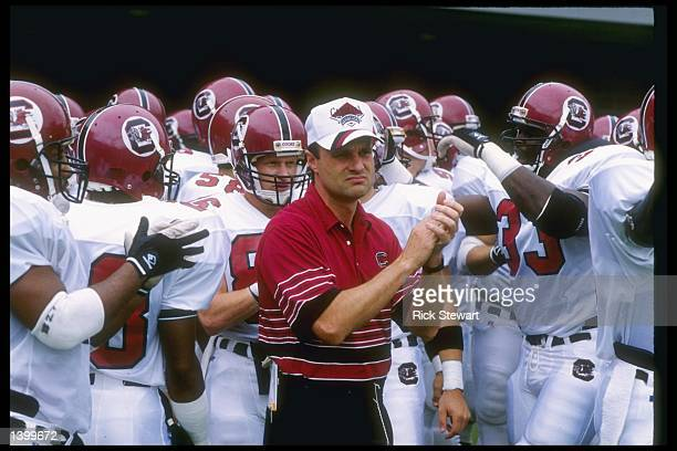 Head coach Sparky Woods of the South Carolina Gamecocks stands on the sidelines with his team during a game against the West Virginia Mountaineers at...