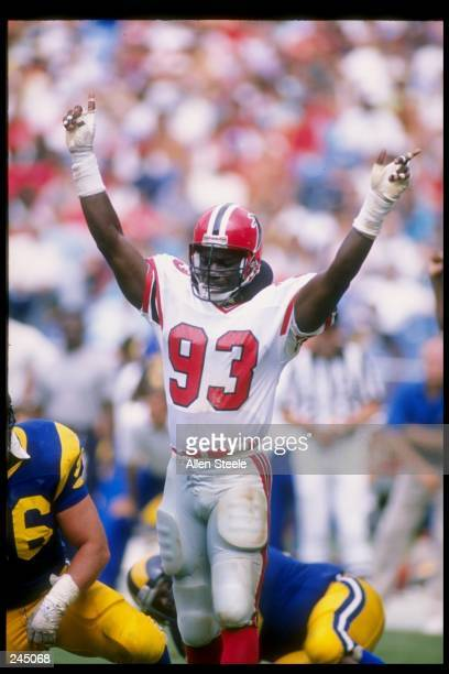 Linebacker Aundray Bruce of the Atlanta Falcons gestures during a game against the Los Angeles Rams at Fulton County Stadium in Atlanta Georgia The...