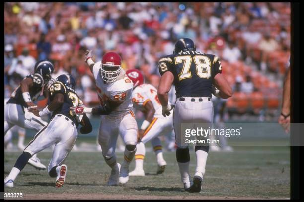 Linebacker Derrick Thomas of the Kansas City Chiefs works against the San Diego Chargers during a game at Jack Murphy Stadium in San Diego California...