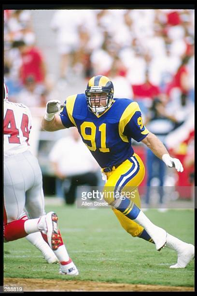 Linebacker Kevin Greene of the Los Angeles Rams moves down the field during a game against the Atlanta Falcons at the Fulton County Stadium in...
