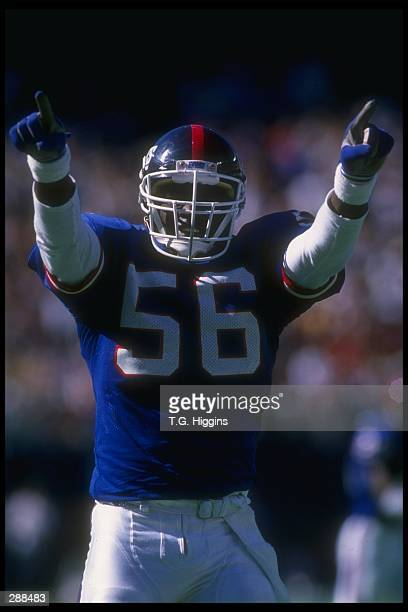 Linebacker Lawrence Taylor of the New York Giants celebrates during a game against the Phoenix Cardinals at Giants Stadium in East Rutherford New...