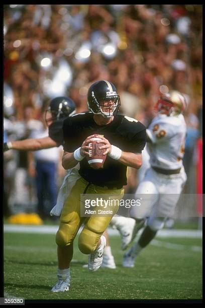 Quarterback Brett Favre of the Southern Mississippi Golden Eagles looks to pass while rolling out during the Golden Eagles 3026 victory over the...
